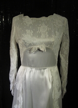 1960's White satin gown with train and lace appliqués/36