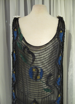 1920's Black beaded dress with yellow and blue flowers/38-40