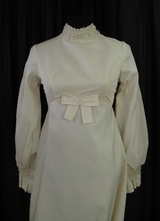 1960's Cream taffeta gown with beaded cuffs and collar/34